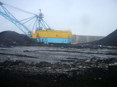 Walking Dragline at an open pit coal mine excavating overburden
